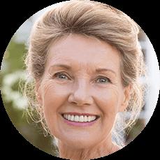 smiling senior woman with full dentures