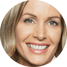 smiling woman showing partial dentures