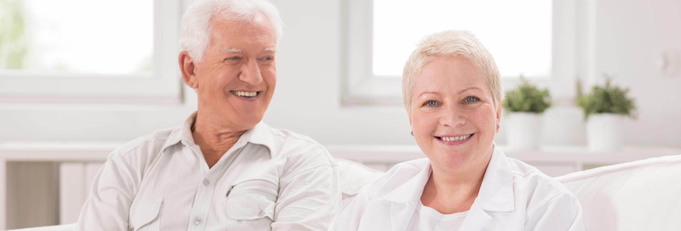 Dental Implants - Senior man and adult nurse in white