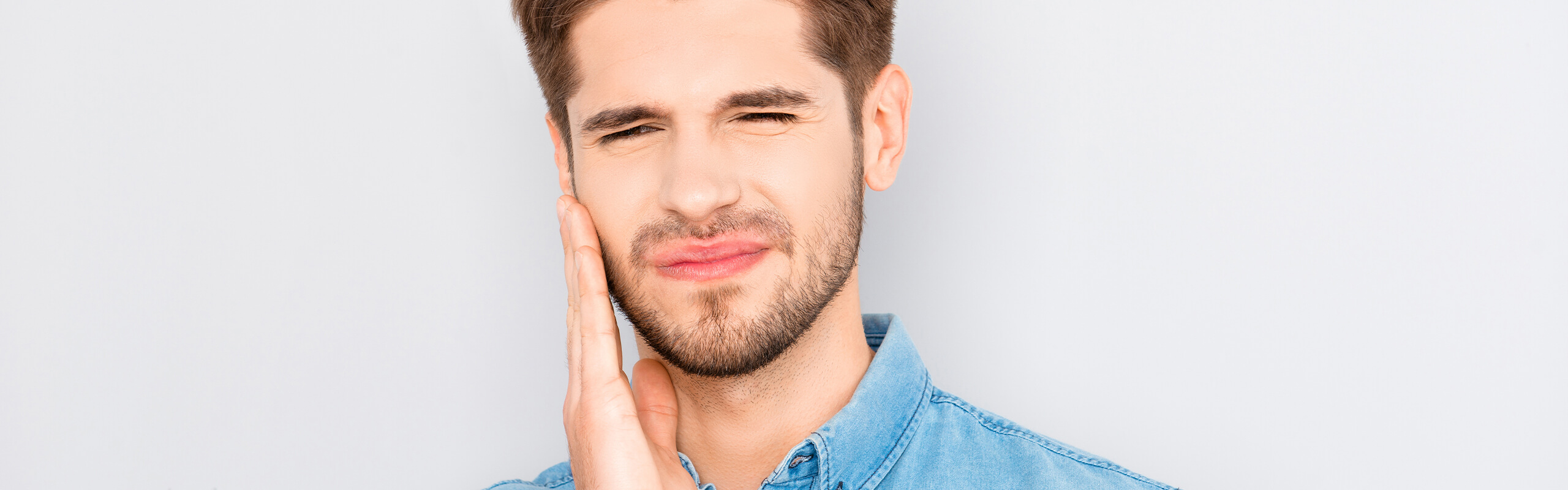 Man holding face with tooth pain